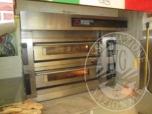 Immagine di Un forno per pizza, una macchina per condizionamento d'aria ed un frigorifero in acciaio inox a due ante